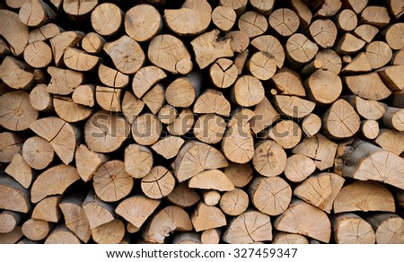 Stack of wood prepared for winter - stock photo