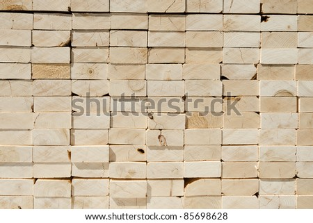 Stack of 2x4 studs background - stock photo