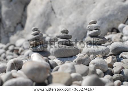 Stack of zen stones on beach;Stones balance on beach;Pile of beautifully stacked stones  - stock photo