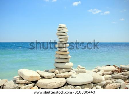 stack of zen stones on the beach - stock photo