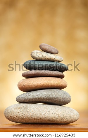Stack of zen stones over brown background - stock photo