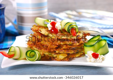 stack of zucchini and potato pancakes for lunch  - stock photo
