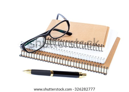 Stack stylish notebook, pen and glasses isolated on white background. - stock photo