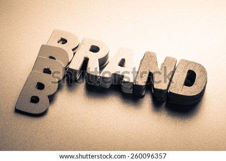 Stack wood letters as Brand word - stock photo
