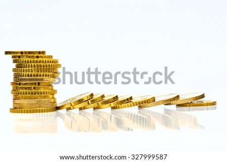 stacked and lying coins symbolfoto for debt, profit collapse and deductions - stock photo