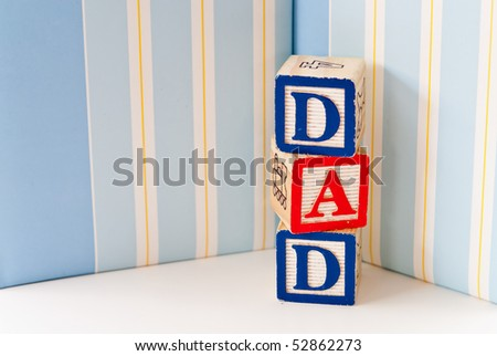 "Stacked Blocks Spelling ""Dad"" - stock photo"