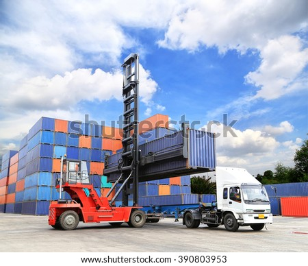 Stacked cargo containers in storage area with blue sky  - stock photo