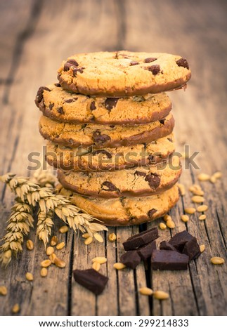 Stacked chocolate chip cookies on the wooden table - stock photo