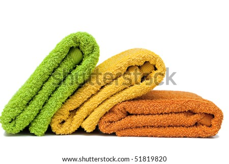 Stacked colorful towels isolated on a white background. - stock photo