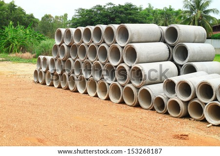 Stacked concrete drainage pipe - stock photo