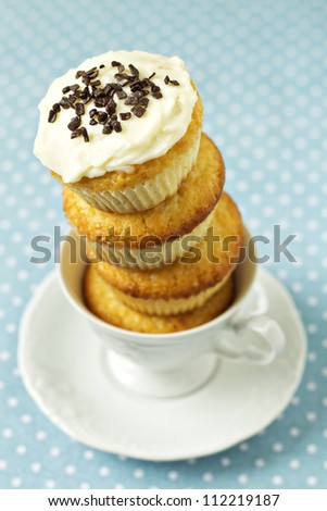 Stacked cupcakes in a cup with frosting on top - stock photo