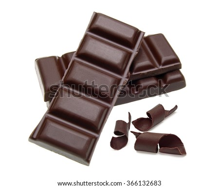 Stacked dark chocolate bars and curls on White background - stock photo