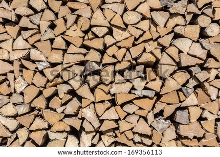 Stacked Firewood. - stock photo