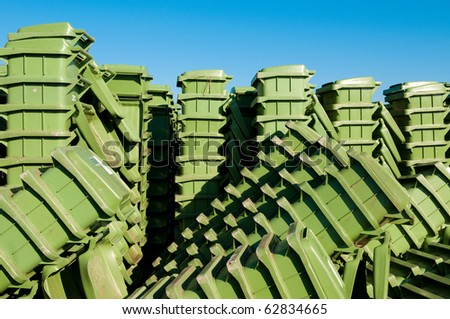 stacked green waste bins - stock photo