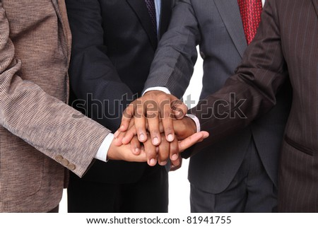 stacked hands, symbolizing team-effort - stock photo