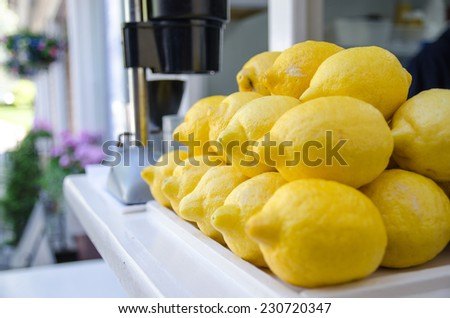 Stacked lemon, ready for squeezing - stock photo