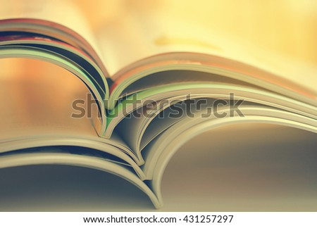 Stacked magazines up close, vintage color tone - stock photo