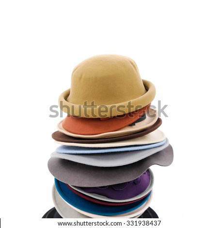 Stacked of colorful female hat - stock photo