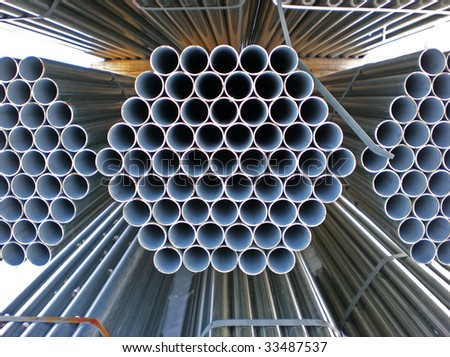 Stacked pipes perspective - stock photo