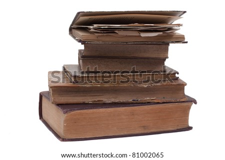 Stacked retro vintage books isolated on white - stock photo
