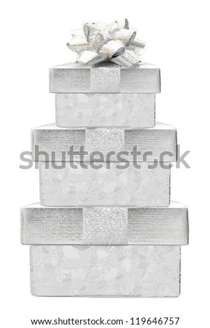 Stacked silver Christmas gift boxes with bow isolated on white - stock photo