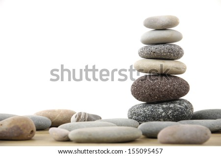 stacked stones with set of stone on a wood board - stock photo