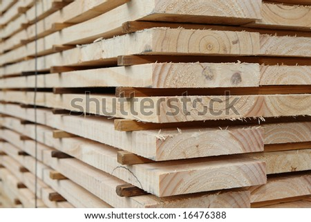 Stacked timber planks - stock photo