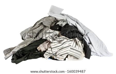 stacked used shirts isolate on white bcakground - stock photo