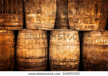 Stacked whisky barrels in monochrome vintage style - stock photo