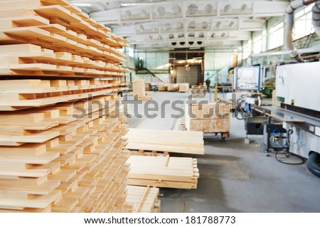 Stacked wood pine timber production for processing and furniture production at woodworking enterprise - stock photo