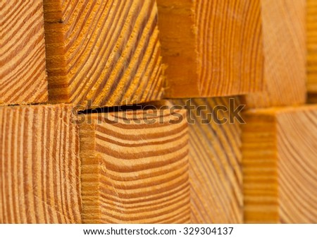Stacked wooden blocks fresh cut with selective focus - stock photo