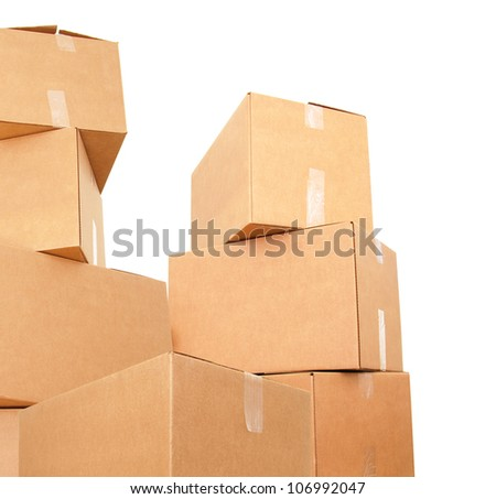 Stacking of corrugated brown boxes - stock photo
