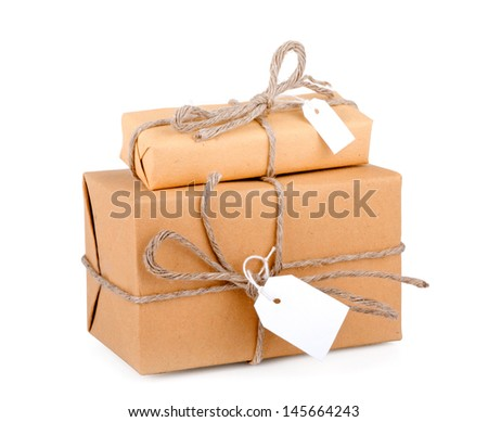 Stacking parcels boxes with kraft paper,isolated on white background. - stock photo