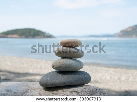 Stacking stones on the wood, different colors stones - stock photo