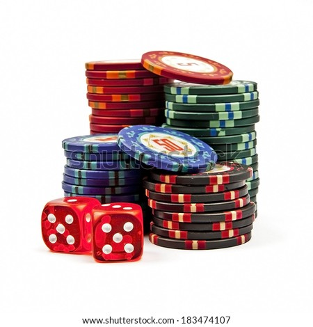 Stacks colored poker chips with dices isolated over white background - stock photo