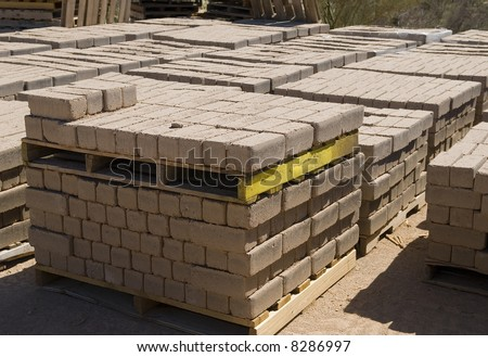Stacks of adobe blocks ready for delivery - stock photo