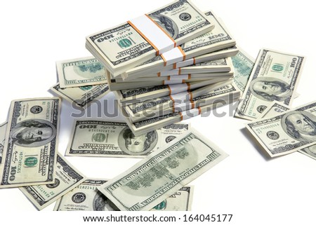 Stacks of american dollars / studio photography of american banknotes of hundred dollar - on white background  - stock photo