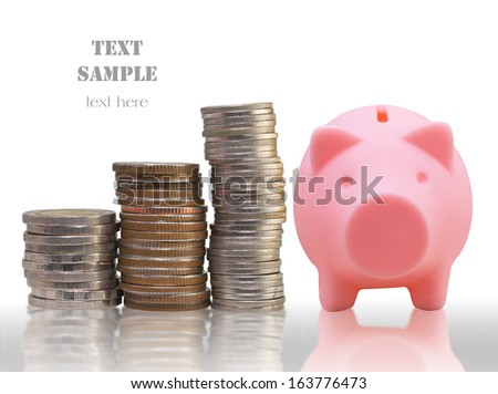 Stacks of coins and pink piggy bank showing growth - stock photo