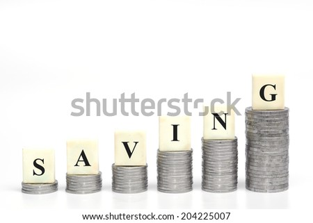 stacks of coins arranged as a graph shape with a word saving / saving money - stock photo