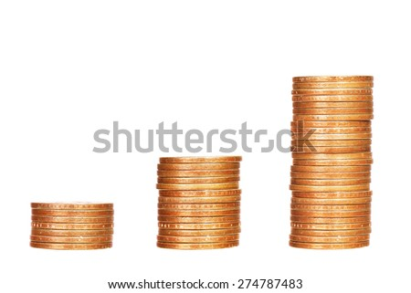 Stacks of coins isolated on white background - stock photo