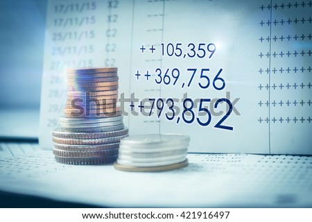 Stacks of coins on banking account in the background,color filter,number ofmoney growth effect,flare - stock photo
