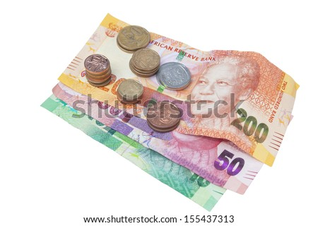 Stacks of coins on three South African Bank Notes - stock photo