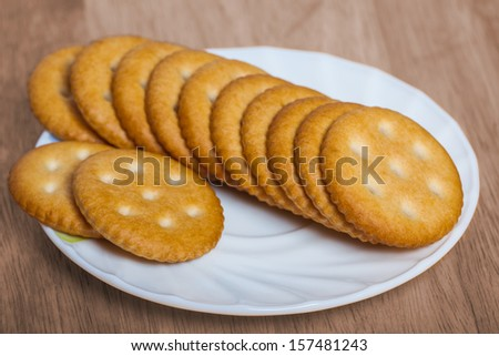 Stacks of cookies on wooden table - stock photo