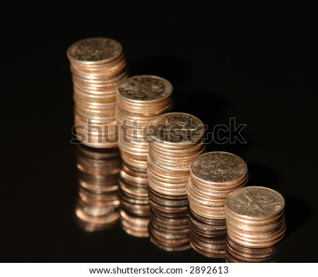 Stacks of dimes against a black background - stock photo