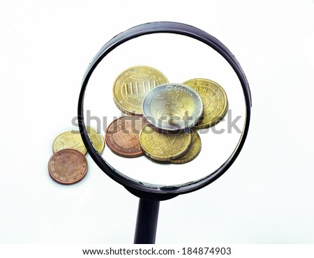Stacks Of Euro Coins Through A Magnifying Glass - stock photo