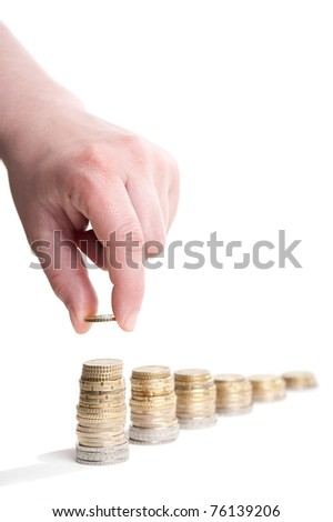 stacks of euro coins with hand, white background - stock photo