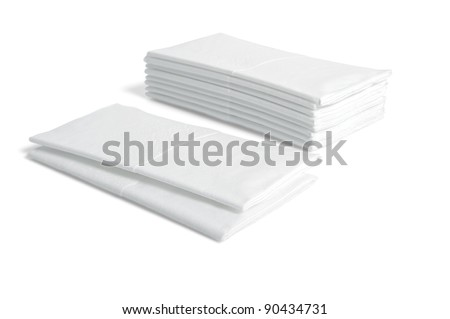 Stacks of folded disposable tissue papers on white background - stock photo