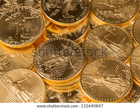 Stacks of gold eagle one troy ounce golden coins from US Treasury mint - stock photo