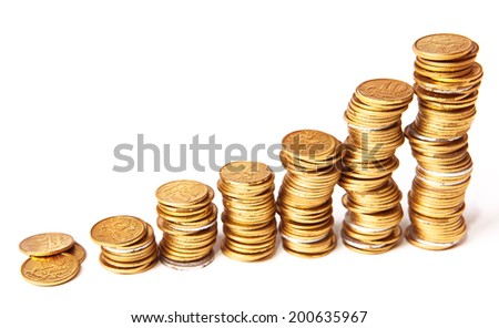 Stacks of golden coins isolated on white. - stock photo