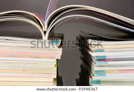 stacks of magazines on gray background - stock photo